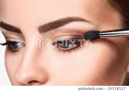 Beautiful female eyes with bright blue make-up and 20558527