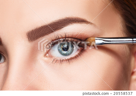 Beautiful female eyes with bright blue make-up and 20558537