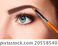Beautiful female eyes with bright blue make-up and 20558540