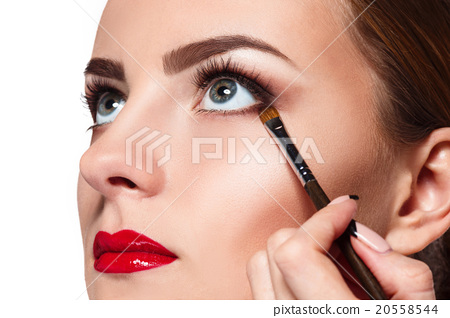 Beautiful female eyes with bright blue make-up and 20558544