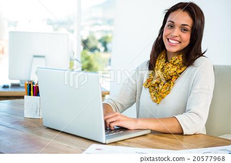 Young girl uses his computer 20577968