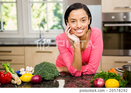 Portrait of smiling brunette in kitchen 20578292