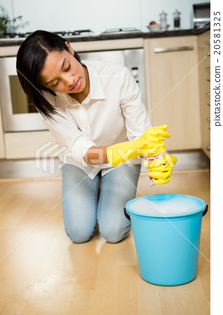 Stock Photo: Attractive brunette cleaning the floor