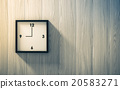 Black clock hanging on the wood wall 20583271