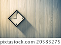 Black clock hanging on the wood wall 20583275