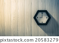 Black clock hanging on the wood wall 20583279