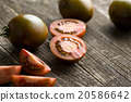 halved dark tomatoes 20586642