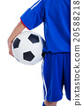 Back view of youth soccer player in blue uniform 20588218