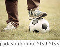 Close up of feet on top of soccer ball 20592055