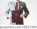 A businessman holding a document 20637394