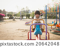 child riding seesaw board at the playground under sunlight 20642048