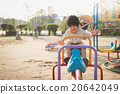 child riding seesaw board at the playground under sunlight 20642049