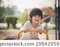 child riding seesaw board at the playground under sunlight 20642050