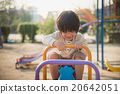 child riding seesaw board at the playground under sunlight 20642051
