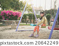 Little asian girl playing swing in the park 20642249