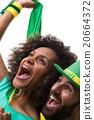 Brazilian couple of fans celebrate on white 20664372