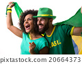 Brazilian couple of fans celebrate on white 20664373