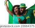 Brazilian couple of fans celebrate on white 20664375