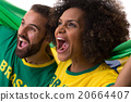 Brazilian couple of fans celebrate on white 20664407
