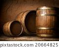 Three wooden barrels 20664825