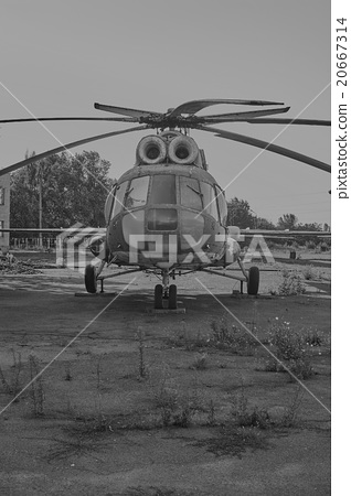 Old helicopter MI-8 at an abandoned aerodrome 20667314