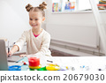 Cheerful little child is creating beautiful image 20679030