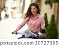 Woman on a scooter on the streets  20727305