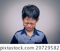Asian boy crying over dark background 20729582