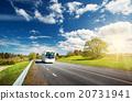 Bus on asphalt road in beautiful spring day 20731941