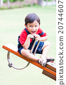 Boy smiling and play at the see-saw  20744607