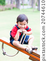 Boy smiling and play at the see-saw  20744610