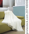 White throw draped over a settee 20748008
