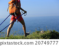 woman backpacker walking on seaside mountain trail 20749777
