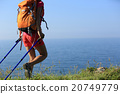 woman backpacker walking on seaside mountain trail 20749779