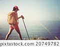 woman backpacker walking on seaside mountain trail 20749782
