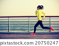 young fitness woman runner running at seaside 20750247
