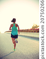 young fitness woman runner running on road 20750266