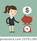 Business woman saving money in a piggy bank 20761106