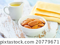almond essential oil and almond in bowl 20779671