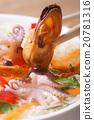 Mussel hold chopsticks close up vertical 20781316