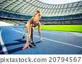 Young sportswoman is at large modern stadium 20794567