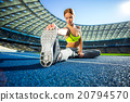 Young sportswoman is at large modern stadium 20794570