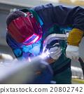 Industrial worker welding in metal factory. 20802742