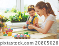 happy family mother and child girl paints eggs for Easter 20805028