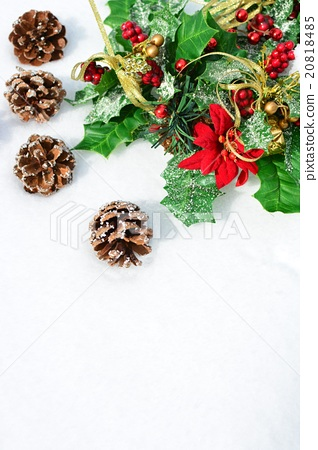 Christmas wreath on snow and pine cones 20818485