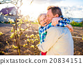 Senior couple hugging in spring garden, sunny 20834151