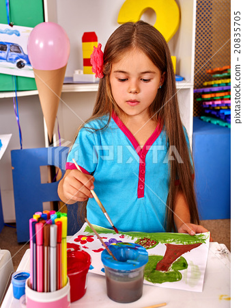Little girl  painting child picture on desk . 20835705