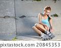 Roller girl resting on the steps 20845353