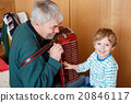 Little kid boy and grandfather playing music 20846117