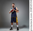 Full length portrait of a basketball player posing 20850556